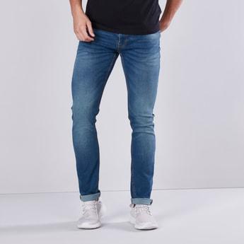 بنطلون جينز سكيني بخصر متوسط الارتفاع وجيوب