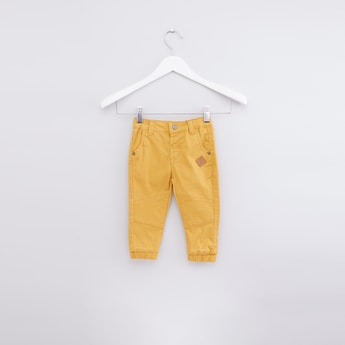 Textured Jog Pants with Button Closure and Pocket Detail