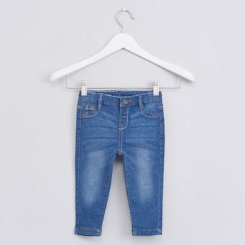 جينز باهت متوسط بخمس جيوب وزر إغلاق