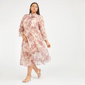 فستان إيه لاين متوسط الطول بأكمام طويلة مع فيونكة بوسي وطبعات أزهار