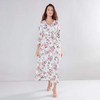 فستان ماكسي بياقة مثلثة وأكمام عريضة وطبعات زهرية