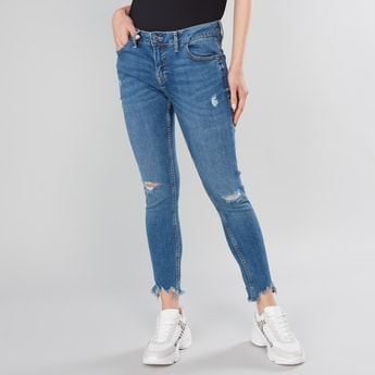 Distressed Jeans with Pocket Detail and Frayed Grazers