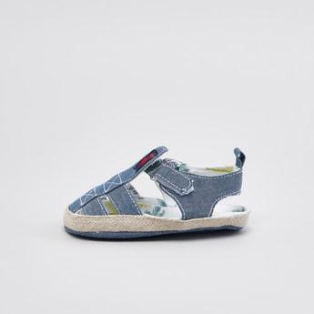 حذاء طويل بارز الملمس بخطّاف وحلقة إغلاق