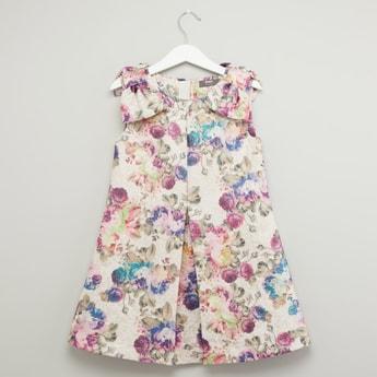 فستان دون أكمام بفيونكة وطبعات زهور