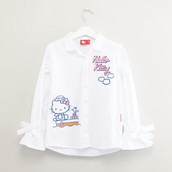 قميص بأكمام طويلة وتفاصيل فيونكة وطبعات هالو كيتي