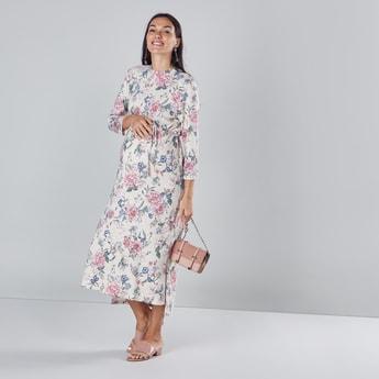 فستان طويل للحوامل بطبعات زهرية مع ياقة مستديرة وأكمام طويلة