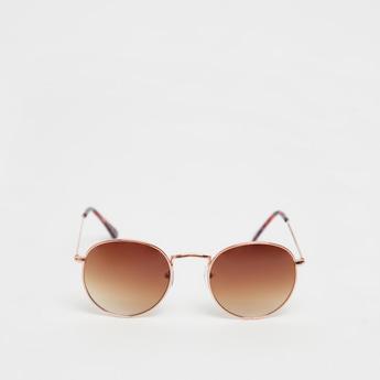 نظارة شمسية سادة مستديرة بسنادات أذن بطبعات
