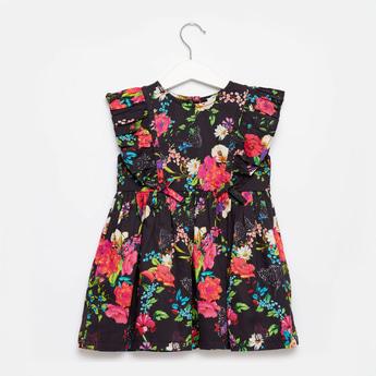 فستان دون أكمام بتفاصيل كشكشة وطبعات أزهار