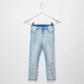 بنطلون جينز كامل الطول بتزيينات وجيوب وحلقات حزام