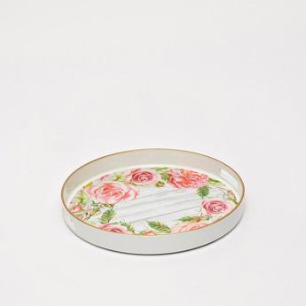 صينيّة مستديرة بطبعات أزهار ومقابض مفرّغة