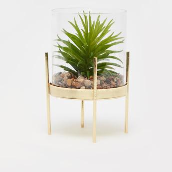 نبات اصطناعي في حاوية زجاجية وحامل 4 أرجل
