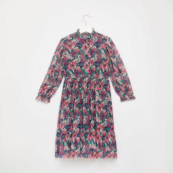 فستان شبكي طويل بأكمام طويلة وفتحة أزرار وطبعات زهور
