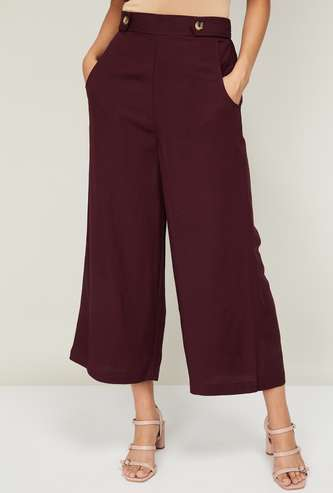 CODE Women Solid Flared Pants
