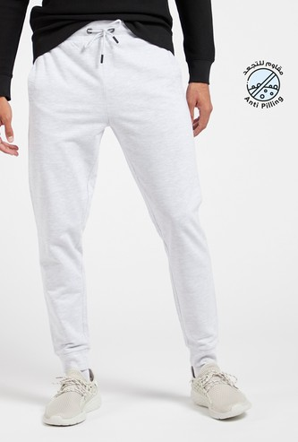 Solid Mid-Rise Joggers with Pockets and Drawstring Closure