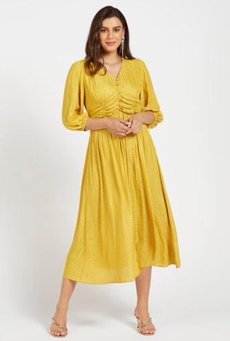 فستان إيه لاين بطبعات بالكامل بياقة على شكل V وحزام ربط