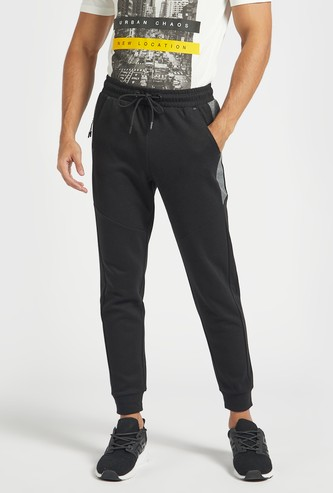 Slim Fit Solid Jog Pants with Zippered Pockets and Drawstring Closure