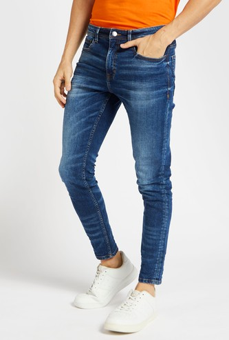 Full Length Carrot-Fit Jeans with Pockets and Button Closure