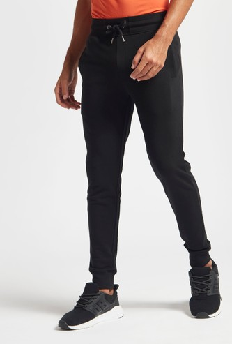 Skinny Fit Solid Mid-Rise Jog Pants with Drawstring Closure
