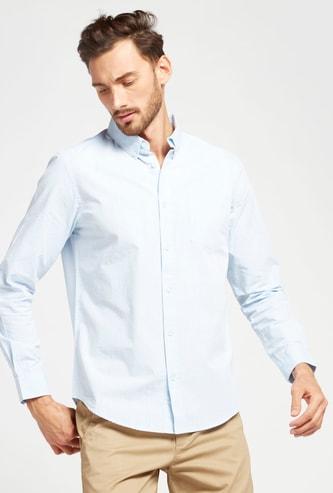 قميص سادة بأكمام طويلة وجيب خارجي