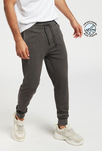 Solid Mid-Rise Skinny Fit Jog Pants with Drawstring Closure