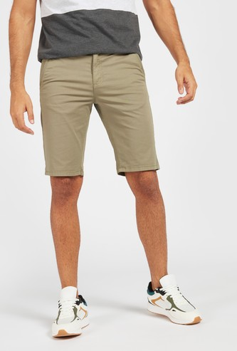 Solid Mid-Rise Chino Shorts with Pockets and Zip Closure