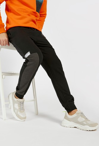 Solid Slim Fit Jog Pants with Drawstring Closure and Side Panel Detail