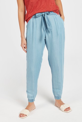 Solid Mid-Rise Harem Pants with Tie-Up Detail and Pockets