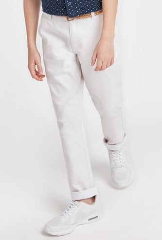 Textured Trousers with Pockets and Zip Closure