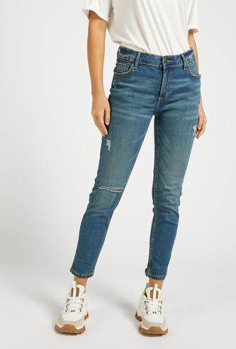 Skinny Fit Ankle Length Ripped Jeans with Button Closure
