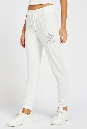 Solid Jog Pants with Patch Print Detail and Drawstring