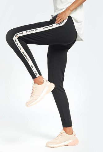 Solid Jog Pants with Drawstring Closure and Side Tape Detail