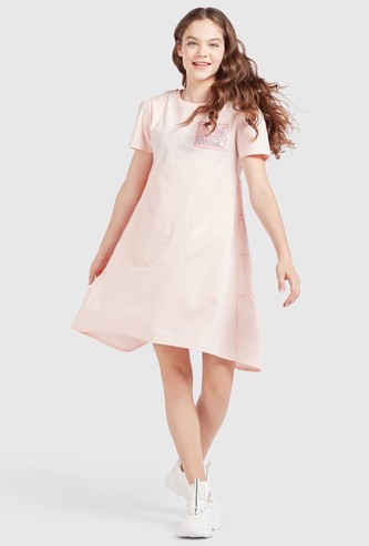 Solid Tiered Oversized Dress with Short Sleeves and Applique Detail