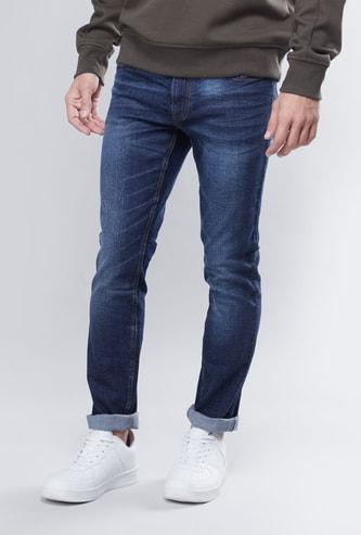 بنطلون جينز سكيني بخصر متوسط الارتفاع ونمط مغسول