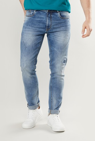 بنطلون جينز ممزق سكيني بخصر متوسط الارتفاع وعروات حزام وجيوب