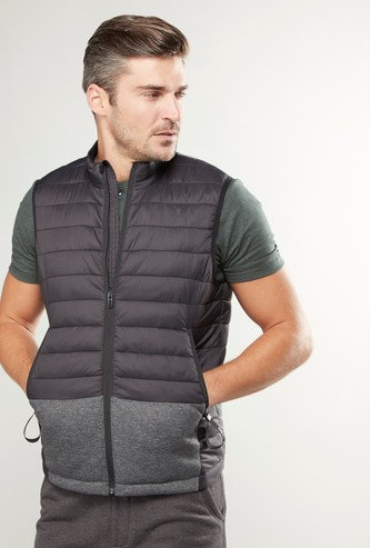 Quilted Sleeveless Gilet Jacket with Pocket Detail and Zip Closure