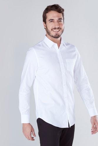 قميص سادة بأكمام طويلة وجيب على الصدر
