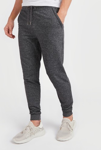 Full Length Textured Mid-Rise Jog Pants with Pocket Detail