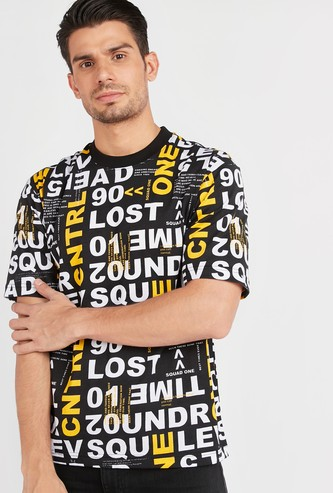 All-Over Typographic Print T-shirt with Round Neck and Short Sleeves
