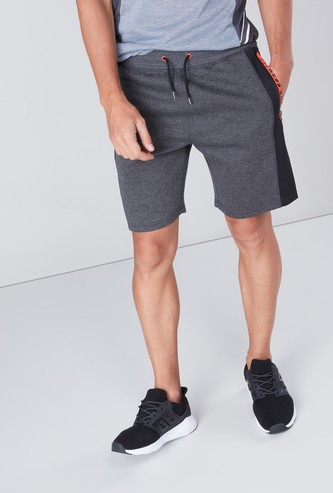Solid Shorts with Drawstring Waist and Printed Zippered Pockets