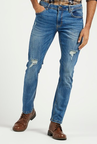 بنطلون جينز ممزق سكيني بخصر متوسط الارتفاع بعروات حزام وجيوب