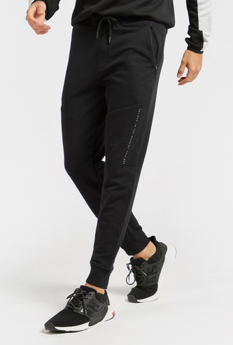 Slim Fit Solid Mid-Rise Jog Pants with Drawstring Closure