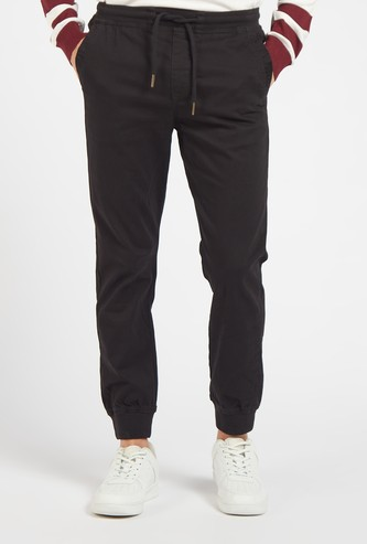 Slim Fit Solid Mid-Rise Jog Pants with Pockets and Drawstring Closure