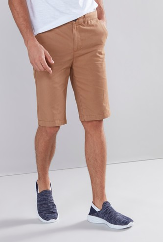 Solid Knee Length Shorts with Button Closure