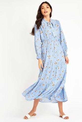 فستان طويل إيه لاين بأكمام بيشوب وتفاصيل فيونكة وطبعات أزهار