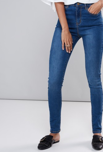 Super Skinny Full Length High-Rise Jeans with Button Closure