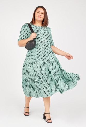 فستان ميدي بياقة مستديرة وأكمام قصيرة بطبعات