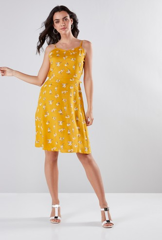 Floral Print Skater Knee Length Dress with Spaghetti Straps and Tie Ups