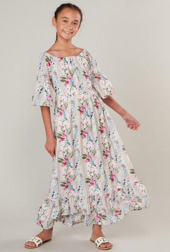فستان بطبعات زهرية بياقة قارب وأكمام قصيرة