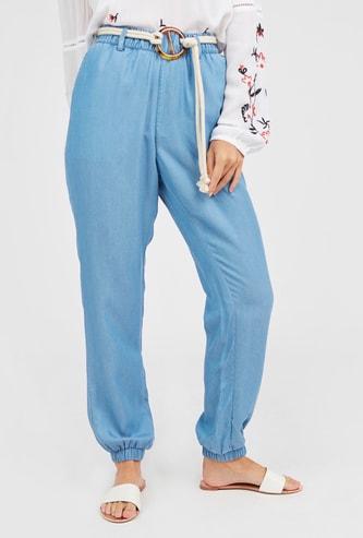 Solid Harem Pants with Belt and Pocket Detail