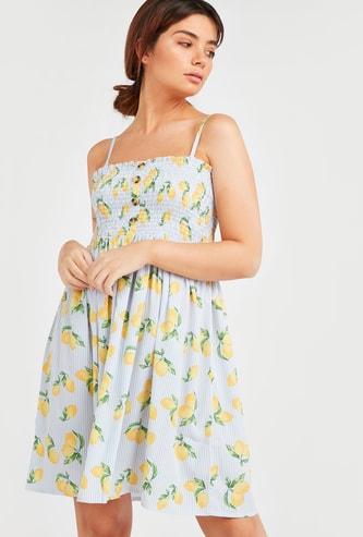 فستان ضيق يتفاصيل مطرزة وبطبعات ليمون
